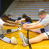 Antawaun Scott, left, stretches with his friend Lane Eubank as the two warm up for Unified Track practice after school on May 1, 2019.<br /> Kelly Lafferty Gerber | Kokomo Tribune