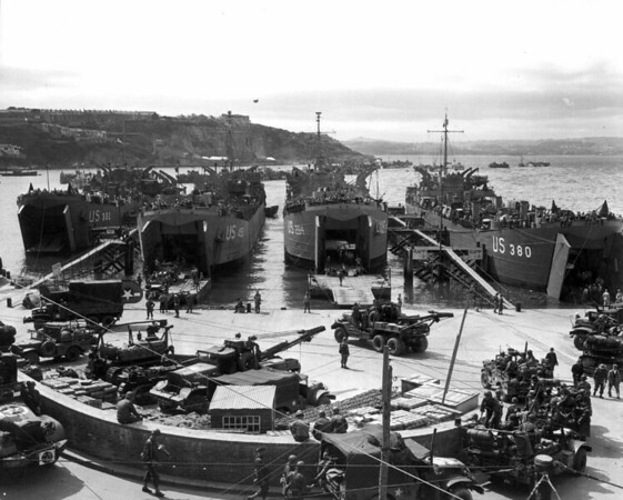 From right to left; USS LST-380, USS LST-284, USS LST-499, and USS LST-382 at Brixham Harbour, England, 1 June 1944, loading up with equipment ready for the cross channel invasion.<br /> US Army Signal Corps photo # SC206438 by Nehez