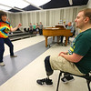 Austin Hewitt, who is an aide for Eastern Middle School's choirs watches as choir teacher Karol Evenson and the middle school choir rehearse for their spring concert at Eastern High School on May 3, 2019.<br /> Kelly Lafferty Gerber | Kokomo Tribune