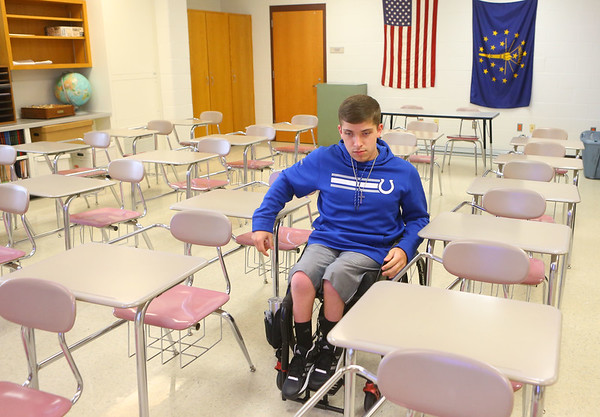 Alex Mula heads through the rows of desks to go to his next class at Northwestern on April 25. Alex, who was born with spina bifida, has used a wheelchair all his life.<br /> Kelly Lafferty Gerber | Kokomo Tribune