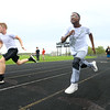 Antawaun Scott, right, runs during Western's Unified track practice on May 1, 2019. Antawaun does the long jump, 4x100 relay, and the 100, 200, and 400 meter dashes.<br /> Kelly Lafferty Gerber | Kokomo Tribune