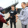 Antawaun Scott, left, and Chris Jeffery play rock, paper, scissors while Luke Lechner watches after Western's Unified track practice on May 1, 2019.<br /> Kelly Lafferty Gerber | Kokomo Tribune