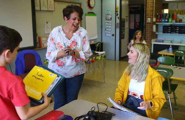 Zara Hooper, right, chats with Lafayette Park third grade teacher Amy Henderson on April 26. Zara was part of a first-year program called Tomorrow's Teachers, where she got college credit through IUK and was able to observe teachers and take field notes.<br /> Kelly Lafferty Gerber | Kokomo Tribune