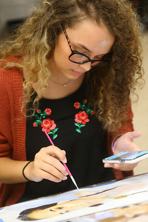 Taylor senior Tori Gilstrap works on a painting in art class at Taylor High School on April 23. Tori has won numerous awards for her art, a passion she discovered after she was diagnosed with Crohn's disease.<br /> Kelly Lafferty Gerber | Kokomo Tribune