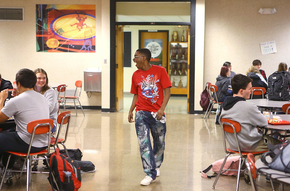 Antawaun Scott, 18, laughs as he greets people in the cafeteria during lunch at Western High School on April 20, 2019.<br /> Kelly Lafferty Gerber | Kokomo Tribune