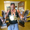 Tipton police officer Terence Napier with some of his medals and trophies from his bodybuilding competitions on June 11, 2019. <br /> Kelly Lafferty Gerber | Kokomo Tribune