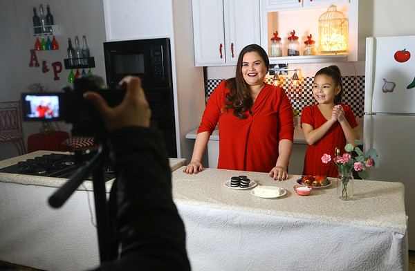 """Grethel Mendoza Pasos Keeney and her daughter Julia film an intro to Grethel's cooking show """"Azucar y pimienta"""" on Jan. 25. Grethel, who lives in Greentown, transformed her garage into a kitchen studio for her Nicaraguan tv show.<br /> Kelly Lafferty Gerber 