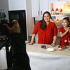 "Grethel Mendoza Pasos Keeney and her daughter Julia film an intro to Grethel's cooking show ""Azucar y pimienta"" on Jan. 25. Grethel, who lives in Greentown, transformed her garage into a kitchen studio for her Nicaraguan tv show.<br /> Kelly Lafferty Gerber 