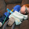 3-year-old Marcus Lively falls asleep with his blanket as he undergoes chest physiotherapy and a respiratory breathing treatment at home on Feb. 16, 2019. Marcus has to wear it three times a day for 30 minutes each. The machine vibrates, which breaks up mucus, and typically puts Marcus to sleep. <br /> Kelly Lafferty Gerber | Kokomo Tribune