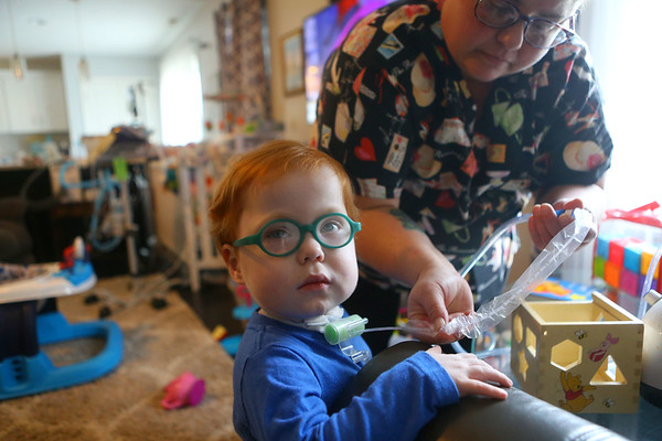 Heather Torres, LPN, uses suction to get secretions from Marcus' trach tube on Feb. 16, 2019.<br /> Kelly Lafferty Gerber   Kokomo Tribune