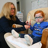 Marcus, 3, watches TV as his mom Kelly Lively feeds him formula via a feeding tube on Feb. 16, 2019. Nurses thought that Marcus, who spent the first part of his life in the hospital due to serious medical conditions when he was born, would die in the hospital. But when Kelly Lively heard his story and saw a photo of him she felt called to be his mom. In 2017, she became his foster mom, and last year his mom after she adopted him. Under Kelly's care, Marcus has made strides in his health and has overcome obstacles that doctors never thought possible.<br /> Kelly Lafferty Gerber | Kokomo Tribune