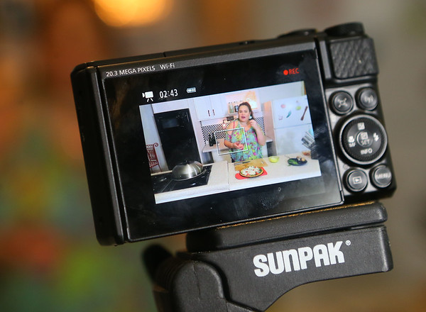 """Grethel, as seen from the back of her camera, films her cooking show """"Azucar y pimienta"""" from her Greentown garage on Jan. 2.<br /> Kelly Lafferty Gerber 