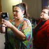 "Grethel Mendoza Pasos Keeney looks over footage on the back of her camera as her mom Carmen Pasos looks over her shoulder. Carmen helped film ""Azucar y pimienta"" while she was visiting Grethel in Greentown in January.<br /> Kelly Lafferty Gerber 