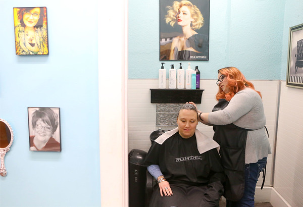 Rebeckah Reichert, begins the process of coloring Sharon Breitenbach's hair on March 26, 2019. Reichert, who was recently hired by Terrie and Co. Salon in Peru, is 80 percent deaf and fluent in American Sign Language.<br /> Kelly Lafferty Gerber | Kokomo Tribune