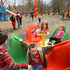 Kids spin on the merry-go-round at Highland Park on Wednesday afternoon, March 13, 2019. With temperatures that reached above 60 degrees, kids and adults took advantage of the warm temperatures and headed outdoors.<br /> Kelly Lafferty Gerber | Kokomo Tribune