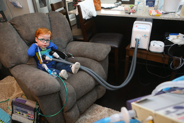 """Marcus is hooked up to a chest physiotherapy and a respiratory breathing treatment machine, or what his mom Kelly Lively calls the """"tickly, wiggly, jiggly, wrap-a-roo,"""" on Feb. 16, 2019. The three year old undergoes the process, which loosens and mobilizes secretion, three times a day. His mom made up the fun name for the machine to make Marcus less scared of the whole process.<br /> Kelly Lafferty Gerber   Kokomo Tribune"""