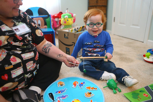 Marcus Lively, 3, laughs as he plays with Heather Torres, LPN on Feb. 16, 2019.<br /> Kelly Lafferty Gerber | Kokomo Tribune