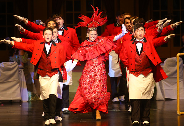 "Casey Clark, center, playing Mrs. Dolly Gallagher Levi, along with the cast of waiters perform the ""Hello Dolly"" song during Eastern's performance of the musical ""Hello Dolly!"" on Friday, March 15, 2019. Kelly Lafferty Gerber 