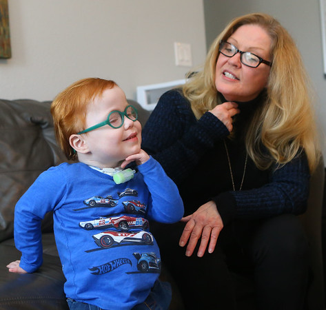 Marcus uses sign language to communicate with his mom Kelly Lively on Feb. 16, 2019. Since Marcus has a trach to help him breathe, it also impedes his ability to speak, so Kelly taught him sign language. Since Kelly became Marcus' foster parent in 2017 and then adopted him last year, his quality of life has vastly improved. He spent the first part of his life in the hospital after he was born with serious medical conditions. <br /> Kelly Lafferty Gerber   Kokomo Tribune