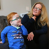 Marcus uses sign language to communicate with his mom Kelly Lively on Feb. 16, 2019. Since Marcus has a trach to help him breathe, it also impedes his ability to speak, so Kelly taught him sign language. Since Kelly became Marcus' foster parent in 2017 and then adopted him last year, his quality of life has vastly improved. He spent the first part of his life in the hospital after he was born with serious medical conditions. <br /> Kelly Lafferty Gerber | Kokomo Tribune