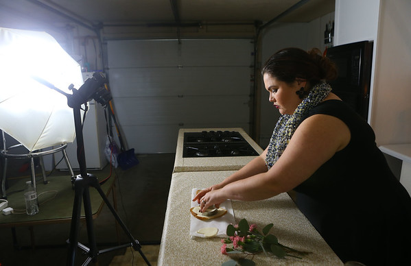 Grethel Mendoza Pasos Keeney films in her Greentown garage for her Valentine's Day cooking show on January 25. Even though it's the middle of winter in Indiana, Grethel wears summery clothing for her Nicaraguan audience who live in a tropical climate.<br /> Kelly Lafferty Gerber   Kokomo Tribune