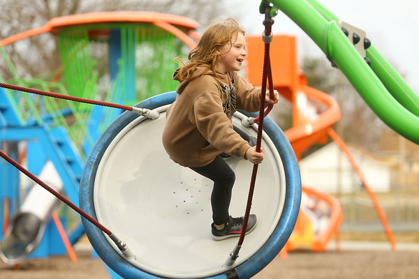 7-year-old Lauralei DeWitt soars on the circle swing at Highland Park on Wednesday afternoon, March 13, 2019. With temperatures that reached above 60 degrees, kids and adults took advantage of the warm temperatures and headed to the park for some outdoor fun.<br /> Kelly Lafferty Gerber | Kokomo Tribune