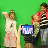 From left: Arabella Ferraro, Averie Moore, Athena Alvarado, Ameliah Ferraro, and Teresa Franke make silly faces and poses as Alohnna Alvarado takes a photo of them in front of a green screen, making it look like they're in front of the Eiffel Tower in Paris, during the Girls in Information and Communications Technology Day at the Kokomo-Howard County Public Library on Saturday, March 30, 2019.<br /> Kelly Lafferty Gerber | Kokomo Tribune