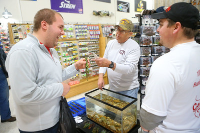 Thomas Gish, left, talks lures with Alan Miller from Ledgerock Lures and Nate Bontrager, right, from B&N Custom Baits during SoreMouth Tackle's grand opening at 1500 N. Reed Road inside the Kokomo Event Center on Saturday, March 30, 2019. Kelly Lafferty Gerber | Kokomo Tribune