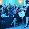 Ladies hand over bills to one of the women of the Little Black Dress event at Bel Air on Friday, May 3, 2019, to benefit the Domestic Violence Shelter.<br /> Kelly Lafferty Gerber | Kokomo Tribune