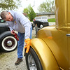 Harry Davis cleans his 1930 Chevy Coupe outside of the Greentown Road Kings garage on April 27, 2019.<br /> Kelly Lafferty Gerber | Kokomo Tribune