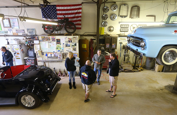 A group gathers in the Greentown Road Kings garage to discuss plans on April 27, 2019.<br /> Kelly Lafferty Gerber | Kokomo Tribune