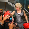 Mike McKibben, one of the women of the Little Black Dress event, hands out firefighter hats at Bel Air on Friday, May 3, 2019, to benefit the Domestic Violence Shelter.<br /> Kelly Lafferty Gerber   Kokomo Tribune