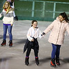 12-year-olds Clare Webster, left, and Shaylin Marion skate hand-in-hand on opening night of The Frozen Sandlot on Tuesday, November 26, 2019.<br /> Kelly Lafferty Gerber | Kokomo Tribune
