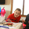 """6-year-olds Camden Geary, left, and Maddox Leedy participate in an experiment during Wrangler and Friends """"Red for Ed"""" free day camp for kids of Howard County teachers on Tuesday, November 19, 2019.<br /> Kelly Lafferty Gerber 