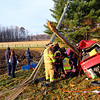 A single vehicle accident injured one person and took down power lines on 350 North between 200 and 300 West on Monday morning Nov. 25, 2019. The red Chevy Cobalt wrapped around a utility pole just behind the driver, trapping him inside. He was awake and talking with firefighers complaining of pain in the shoulder. Until power was cut from the high voltage power lines that surrounded the car, rescuers were unable to cut him out. Power was cut after about 30 minutes with about 20 minutes to cut him out before he was transported by air helicopter to St. Vincent in Indianapolis.<br /> Tim Bath   Kokomo Tribune