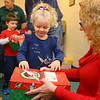 Mia Meier, 3, fills a shoebox for Operation Christmas Child with toys and toiletries with the help of Carrie Worland at Brookside Free Methodist Church on November 13, 2019. <br /> Kelly Lafferty Gerber | Kokomo Tribune