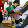 Western Primary 2nd graders load collected cans and dry goods into boxes and move them to the back door of the school on Nov. 25, 2019. The kindergarten, first and second graders collected the 8000 plus food items during a contest at the school to be donated to the Rescue Mission. Jay Horrell, Kian Kennedy, Garrett Kane and Gavyn Hancock pack a box full of food that was collected.<br /> Tim Bath   Kokomo Tribune