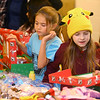 Aaliyah Power, 7, right, and Arianna DeWald, 7, left, pick out toys to put in shoeboxes during a shoebox packing party for Operation Christmas Child at Brookside Free Methodist Church on November 13, 2019.<br /> Kelly Lafferty Gerber | Kokomo Tribune