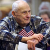 Veterans are recognized at Primrose Retirement Community of Kokomo during a ceremony on Nov. 7, 2019. Each veteran received a certificate, flag and flag pin in recognition of their service to our country from Primrose, Kindred Hospice, American Legion and VFW. Bud Harland listens to the wives of veterans being recognized.<br /> Tim Bath | Kokomo Tribune
