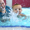 Taylor Elementary kindergarten students learn to swim at the YMCA on Thursday Nov. 14, 2019. Hunter Redman swims to the wall.<br /> Tim Bath | Kokomo Tribune