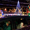 We Care Park lights on the first night of the season on Thursday November 28, 2019. The switch was thrown at 6 p.m. by Cheyanne and Cierra Keown in memory of their brother Chad who died 2 years ago. Ten year-old Ruby Freeland and her family ride through the lights.<br /> Tim Bath | Kokomo Tribune