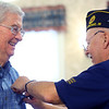 Veterans are recognized at Primrose Retirement Community of Kokomo during a ceremony on Nov. 7, 2019. Each veteran received a certificate, flag and flag pin in recognition of their service to our country from Primrose, Kindred Hospice, American Legion and VFW. Dave Johnson is gets a flag pin from David Taffe from American Legion Post 6.<br /> Tim Bath | Kokomo Tribune