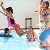 Mariah Patterson has no problem jumping in as Taylor Elementary kindergarten students learn to swim at the YMCA on Thursday Nov. 14, 2019.<br /> Tim Bath | Kokomo Tribune