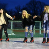 From left: Ashlynn McClure, 12, Reyce Gibson, 13, and Betsy Tweed, 13, keep each other upright as they skate together during opening night of The Frozen Sandlot on Tuesday, November 26, 2019.<br /> Kelly Lafferty Gerber | Kokomo Tribune