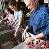 Volunteers from Cutler Ridge church in Flora make the cranberry salad for the Rescue Mission on Nov. 25, 2019. The meal served at Grace United Methodist Church, is a traditional Thanksgiving meal that will be delivered to shut-ins at 10:00 a.m. and served at the church's fellowship hall on Thanksgiving Day, from 11:30 a.m. - 1:00 p.m. About 900 people are expected to be served. Elle Wolf, Dana Dutter and Connie Rece cut grapes for the salad.<br /> Tim Bath | Kokomo Tribune