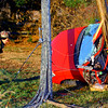 A single vehicle accident injured one person and took down power lines on 350 North between 200 and 300 West on Monday morning Nov. 25, 2019. The red Chevy Cobalt wrapped around a utility pole just behind the driver, trapping him inside. He was awake and talking with firefighers complaining of pain in the shoulder. Until power was cut from the high voltage power lines that surrounded the car, rescuers were unable to cut him out. Power was cut after about 30 minutes with about 15 minutes to cut him out before he was transported by air helicopter to St. Vincent in Indianapolis. Galveston VFD chief Brett Ahrens talks with the driver while they wait for the power to be cut<br /> Tim Bath   Kokomo Tribune