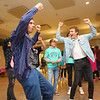 Trent Mote, left, teaches volunteer Trevor White some new dance moves during Bona Vista's Let's Glow 80's Crazy Dance at UAW 685 on Friday, November 15, 2019.<br /> Kelly Lafferty Gerber | Kokomo Tribune