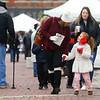 Lacy Schwenk, left, walks hand-in-hand with her 7-year-old daughter Hilary Lawson during the Peru Christkindlmarkt on Friday, November 29, 2019.<br /> Kelly Lafferty Gerber | Kokomo Tribune