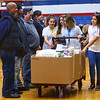 Central Middle School student ambassadors present the food collected for veterans at Jackson Street Commons at the school's Veterans Day Program on Monday Nov. 11, 2019.<br /> Tim Bath | Kokomo Tribune