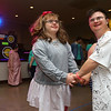 Faith Rogers, left, and Liam Morrison dance together during Bona Vista's Let's Glow 80's Crazy Dance at UAW 685 on Friday, November 15, 2019.<br /> Kelly Lafferty Gerber | Kokomo Tribune